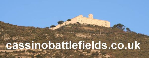 The words are Battlefield Tours to Monte Cassino, Anzio and Salerno in Italy